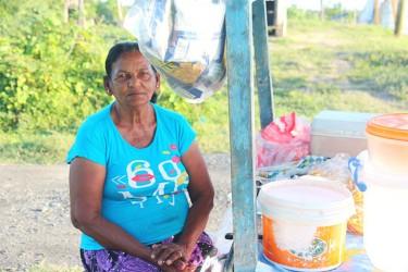 Vendor Parbattie Ali called Auntie Data selling at her stall
