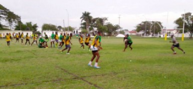 The National Rugby squad going through their paces yesterday at the National Park playfield.