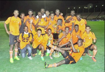 Newly crowned champions Slingerz FC posing with the Kashif and Shanghai championship trophy following their 2-0 victory over arch-rivals Alpha United