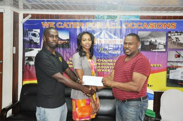 Petra Organization Co-Director (right) collecting the sponsorship cheque from Star Party Rental representative Robert Joseph (left) while fellow company employee Kesheke Washington looks on.