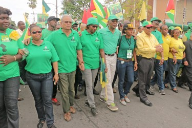 APNU+AFC presidential candidate David Granger (centre) leading his team yesterday.