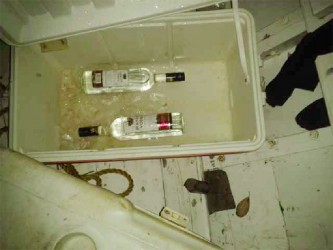 The alcohol that was in the boat that collided with the craft that Kelton Benjamin was in.