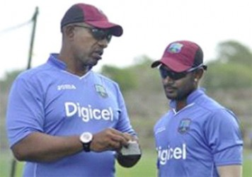 New head coach Phil Simmons (left) and captain Denesh Ramdin compare notes during the camp. (Photo courtesy WICB Media)