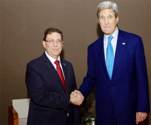 John Kerry (right) shakes hands with Cuban Foreign Minister Rodriguez before meeting on sidelines of Summit of Americas in Panama, April 10, 2015. Photo by U.S. Department of State