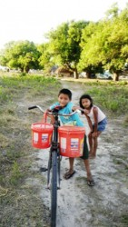 A child and his sister using a bicycle to fetch water to their home in Karaudarnau yesterday. Drought is affecting the Deep South Rupununi community