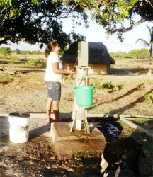 A resident operates the lone pump in the centre of the Karaudarnau village that provides water to residents.