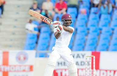 Devon Smith essays a trademark back-cut on the penultimate day of the first Test between West Indies and England on Thursday, April 16, 2015 at the Vivian Richards Cricket Ground. Photo by WICB Media/Randy Brooks of Brooks Latouche Photography