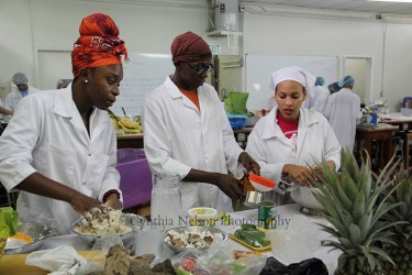 Three members of group St Vincent & The Grenadines hard at work (Photo by Cynthia Nelson)