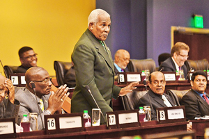National Security Minister Carl Alfonso speaks on the report in Parliament yesterday.