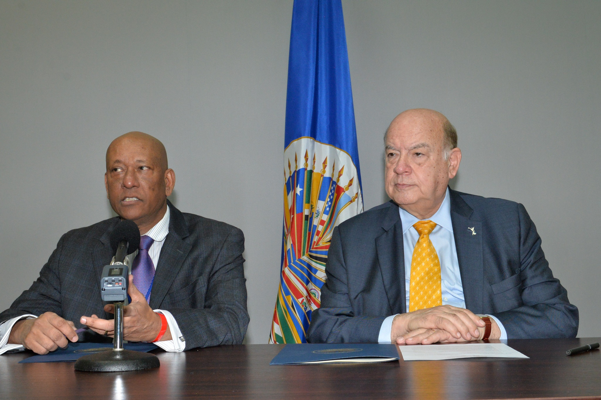 Secretary General of the Organisation of American States (OAS), José Miguel Insulza (right), and the Permanent Representative of Guyana to the Organisation, Bayney Karran (OAS photo)