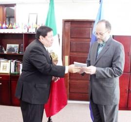 Ivan Roberto Sierra –Medel (left) and Caricom Secretary General Irwin LaRocque (Caricom photo)