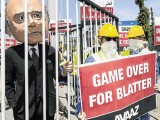 An activist wears a giant mask depicting FIFA President Sepp Blatter during a protest yesterday by the Avaaz.org organisation in Zurich, Switzerland, prior to today's Fifa congress. Avaaz.org wants Blatter to be held accountable for the corruption at Fifa ENNIO LEANZA/EPA