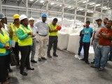 Minister in the Ministry of Social Protection Simona Broomes  addressing a group of workers at the Enmore Packaging Plant (GINA photo)