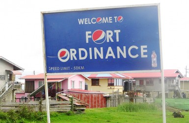 The misspelt village sign, which should read 'Welcome to Fort Ordnance'