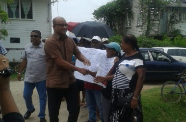 Former President Bharrat Jagdeo greeting supporters at the last court appearance.