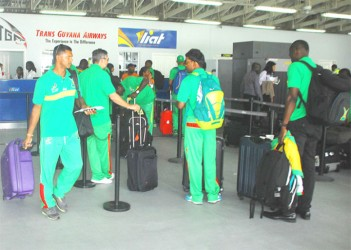 Shivnarine Chanderpaul, left, and some other members of the Amazon Warriors team prior to the team's departure for Barbados yesterday. (Orlando Charles photo)
