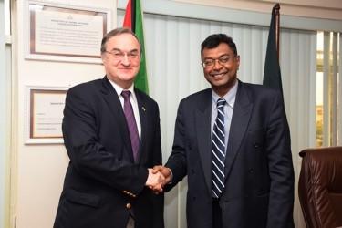 Public Security Minister,  Khemraj Ramjattan (right) greets Nikolay Smirnov, Russian Ambassador to Guyana. (GINA photo)