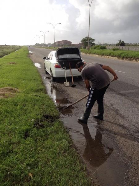 Brijraj Ramsaroop cleaning up along the  East Coast Highway