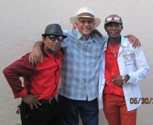 Harry Bissoon (centre) and singer Roger Hinds (right)