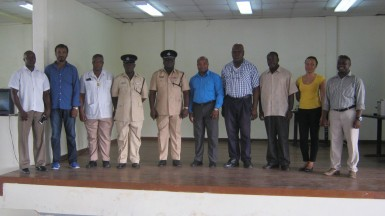 Commander Stephen Mansell (fifth from left), stands with Halim Khan (second from left) Patrick Chimedu Onwuzirike (sixth from left), Eon Nicholson (fourth from right) and representatives of D Division and the religious organisations at the orientation.