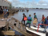 Students and other passengers disembarking a speedboat