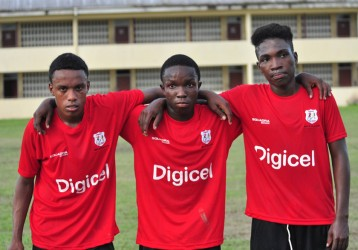 Kwakwani goal-scorers in chronological order from right to left- Linden James, Kevin Carter and Cassius Campbell posing for a photo opportunity following their win over Harmony Secondary