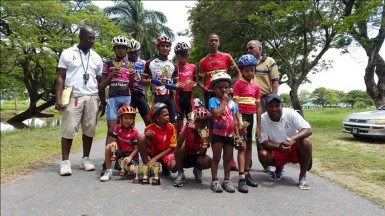 Yesterday's top performers posing with their trophies after the BMX programme in observance of International Olympic Day.
