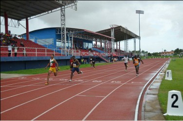 Compton Caesar (lane 5) powers to victory in the 17 and under 200m event.