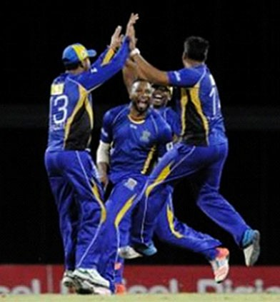 Barbados Tridents celebrate the capture of another Guyana Amazon Warriors wicket. (Photo courtesy CPL website)