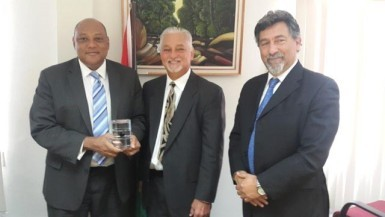 Minister of Governance, Raphael Trotman (left), with REPSOL executives Allan E. Kean (centre) and Giancarlo Ariza (GINA photo)