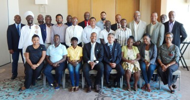 FIFA Head of Associations Primo Corvaro (4th from right) and GFF Normalization Committee Chairman Clinton Urling (4th from left) are all smiles along with the members of the Normalization Committee, GFF Associations and Affiliates following the conclusion of the GFF Extraordinary Congress at the Marriott Hotel