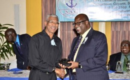 President David Granger (left) presenting Stephen Fraser with an award from the Shipping Association of Guyana, for his contribution to the Maritime Industry. The Shipping Association of Guyana held its annual dinner and award ceremony at the Pegasus Hotel last evening. (GINA photo)