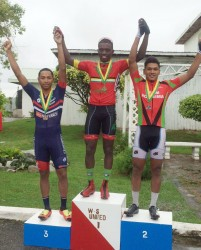 The top three men's finishers of the National Road Race Championship are all smiles on the podium. Winner, Hamza Eastman is flanked by Geron Williams (left) and Alanzo Greaves (right).