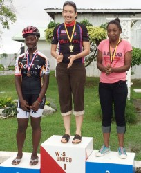 The top women's performers are recognized on the podium yesterday afternoon. From left are Toshwanna Doris, first place finisher, Claire Fraser-Green and Marica Dick