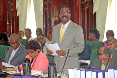 Attorney General Basil Williams speaking in Parliament yesterday