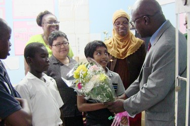 Chief Education Officer Olato Sam with the top performer of St Gabriel's Primary School. (Ministry of Education photo)