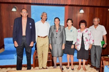 President David Granger (second from left), Minister of Social Cohesion, Amna Ally (second from right) and members of the Scout Association during a meeting at the Ministry of the Presidency today. (GINA photo)