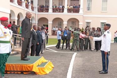 President David Granger (on dais) preparing to take the salute