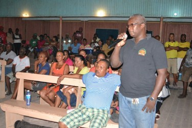 A resident of Kwakwani raising an issue at the meeting with Minister of Governance, Raphael Trotman (Ministry of Governance photo)