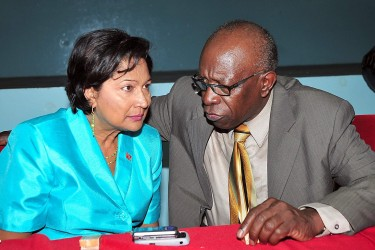 Prime Minister Kamla Persad Bissessar and former UNC Chairman Jack warner at a Cacaus meeting held at the Reinzi Complex, Couva on 16th June, 2010