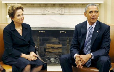 U.S. President Barack Obama (R) meets with Brazil's President Dilma Rousseff in the Oval Office of the White House in Washington June 30, 2015. REUTERS/Kevin Lamarque