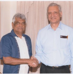 Dr Steve Surujbally (left) and Kamalesh Sharma on Sunday (GECOM photo)