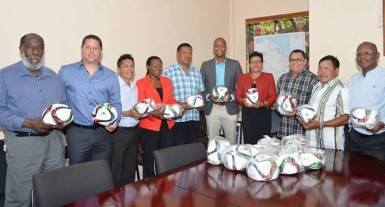 Members of the GFF Normalization Committee and officials of the Ministryof Indigenous Affairs posing for a photo opportunity following the handing over ceremony held at the latter's head office. (Orlando Charles photo)