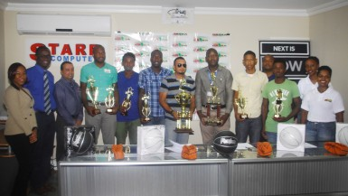 The various team and individual winners alongside members of the GABA executive displaying their prizes following the conclusion of the presentation ceremony held at the Starr Computers Conference Room on Brickdam.