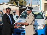 A smiling Police Commissioner Seelall Persaud (right) accepts the keys to 11 new vehicles from Public Security Minister Khemraj Ramjattan. The vehicles, which were handed over yesterday, will be used for patrol purposes in the various police divisions. They were originally intended for community policing groups, but were given to the police force instead in light of its shortage of vehicles.