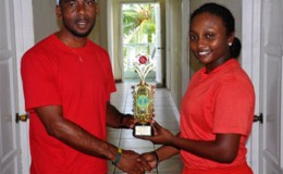 MVP Plaffiana Millington  collects her prize from coach of the Berbice team Andre Percival.