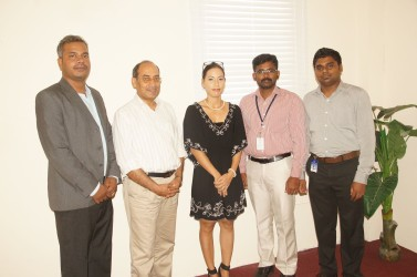 Texila officials at the university's Goedverwagting campus. Vice Chancellor Dr. Dilip Kumar Patnaik is second from left.