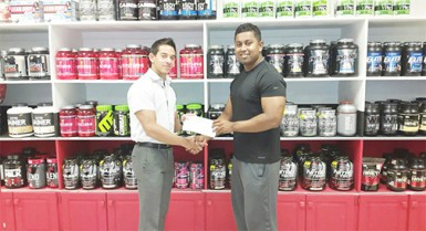 Organizing Secretary of the GABBFF, Videsh Sookram (right) receiving the sponsorship cheque from Fitness Express' CEO, Jamie McDonald on Thursday at the company's 47 John and Sheriff Streets location.