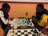 Anthony Drayton (left) of Guyana opposes Andrew Mellace of Jamaica during last year's Umada Cup which was held in Guyana. The tournament was hosted by the World Chess Federation.