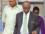 Jack Warner leaves the Port of Spain Magistrate's Court yesterday. (Trinidad Express photo)